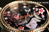 Женские наручные часы с миниатюрами
